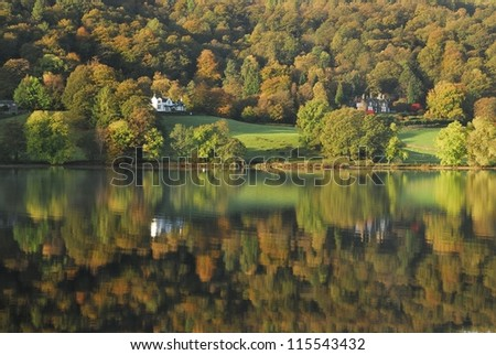 English Lake District autumn colours and reflections. View of Grasmere lake. - stock photo