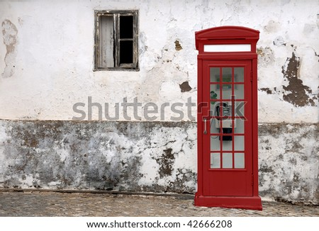 English red kiosk in grunge wall - stock photo