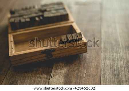 English rubber stamps the word idea in the wood box. - stock photo