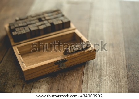 English rubber stamps the word share in the wood box. - stock photo