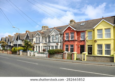 English street of terraced houses, without parked cars - stock photo