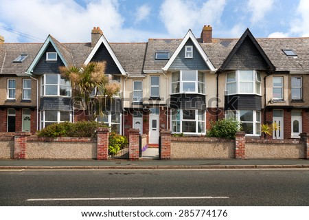 English street of terraced houses, without parked cars. - stock photo