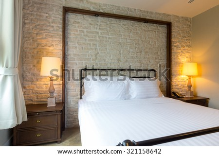 English style luxury master bedroom with pillow set - stock photo