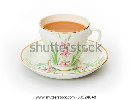 English tea served in a hand painted cup and saucer - stock photo