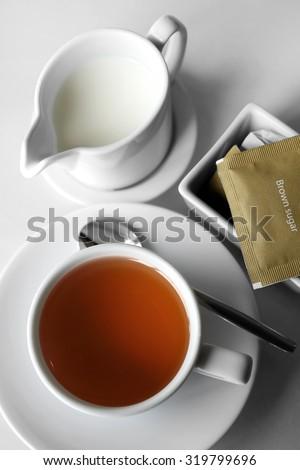 English tea with brown sugar and milk,tea set with shadow - stock photo