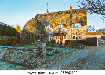 English Village Cottage thatched house - stock photo