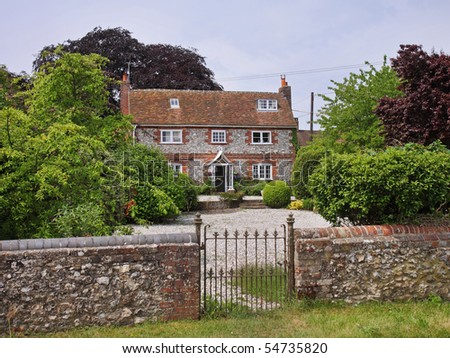 English Village Manor House and gardens - stock photo