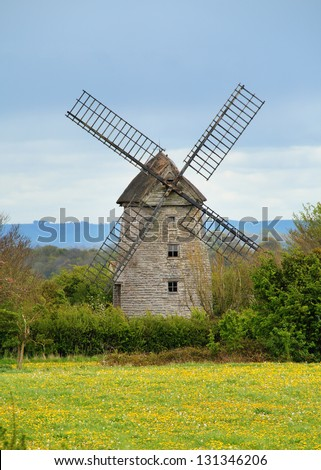 English Village Windmill behind an meadow