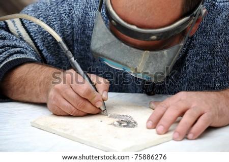 engraver in stone - stock photo