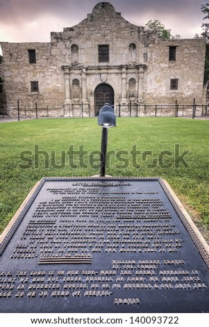 Engraving of Col Travis' 'Victory or Death' letter in front of the Alamo - stock photo