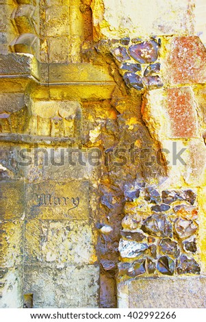 Engraving on Canterbury Cathedral Walls in Canterbury in Kent of England. It is one of the most famous cathedrals in England. It is the Archbishop of Canterbury Cathedral. - stock photo