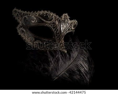 enigmatic carnival mask isolated on black - stock photo