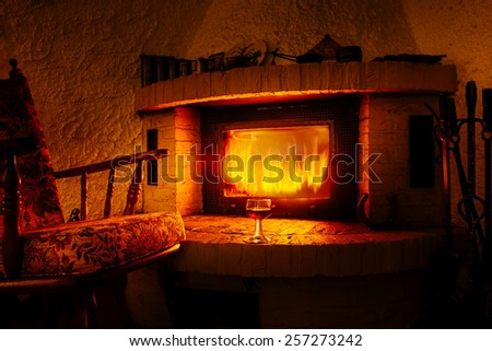 Enjoy at the fireplace - stock photo