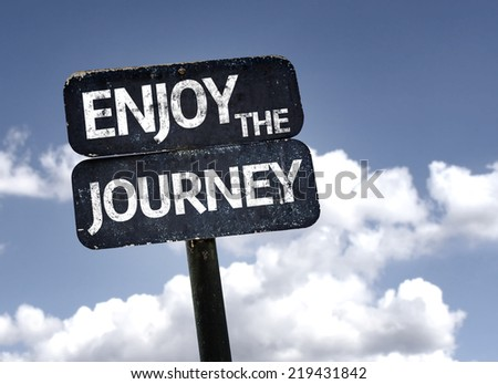 Enjoy The Journey sign with clouds and sky background - stock photo