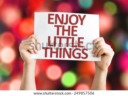 Enjoy the Little Things card with colorful background with defocused lights - stock photo