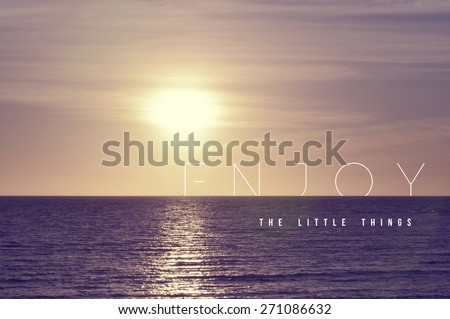 Enjoy the little things motivational inspiring quote concept with soft light summer sunset landscape background ideal for print card and poster design. - stock photo
