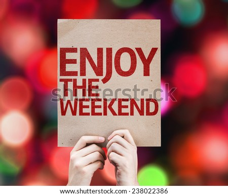 Enjoy The Weekend card with colorful background with defocused lights - stock photo