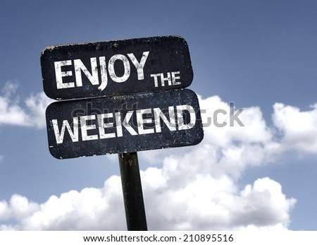 Enjoy the Weekend sign with clouds and sky background  - stock photo