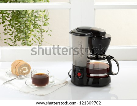 Enjoy your breakfast or coffee break with coffee maker and boiler machine - stock photo