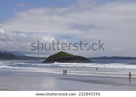 Enjoying a summer day by the North Pacific at Incinerator Rock. Pacific Rim National Park, Vancouver Island, British Columbia, Canada - stock photo