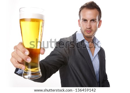 Enjoying a tall cool beer - stock photo