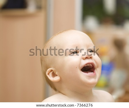 Enjoying baby face close-up - stock photo
