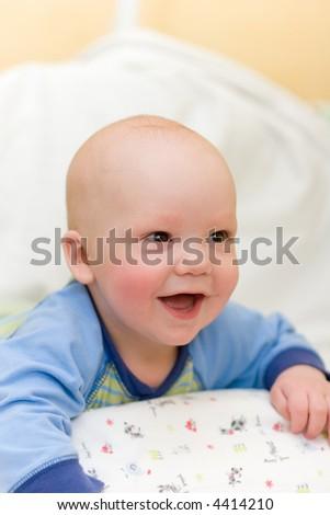 Enjoying baby on bed - stock photo