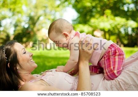 Enjoying life - happy mother with child - stock photo