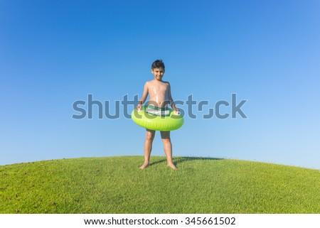 Enjoying on beautiful grass meadow - stock photo