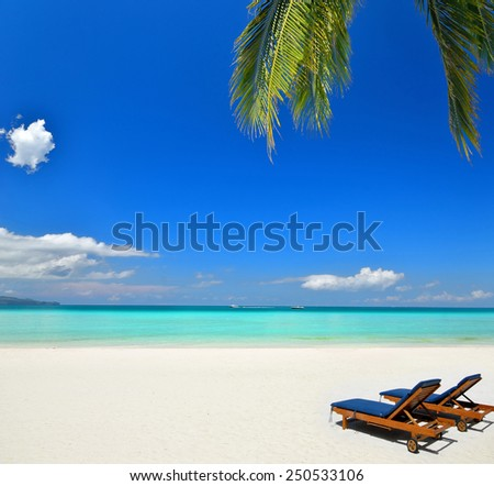 Enjoying perfect vacation at the tropical beach -- Two tanning beds on the beach  - stock photo