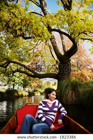 Enjoying scenery at christchurch while punting in Avon river