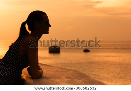 Enjoying the sunset view. - stock photo