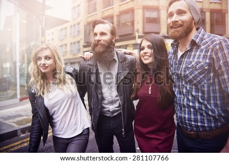Enjoying the time with friends in the city - stock photo
