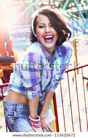 Enjoyment. Gladness. Expressive Woman in Checkered Shirt with Toothy Smile - stock photo