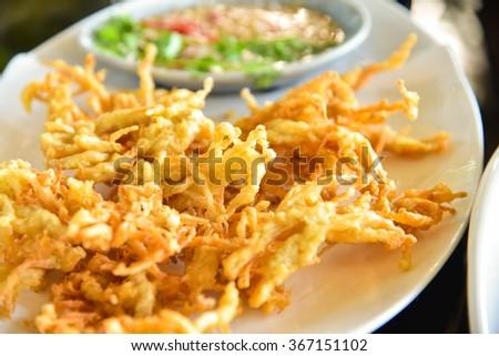 Enoki mushrooms fried - stock photo