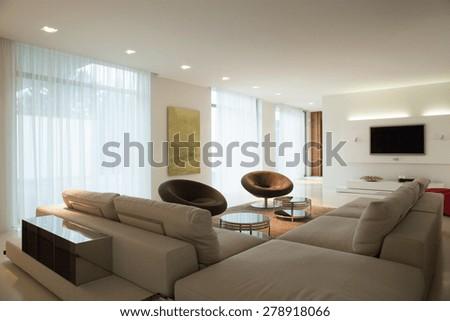 Enormous comfortable sofa in cozy main room - stock photo