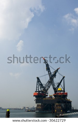 Enormous floating cranes at harbour off Rotterdam - stock photo