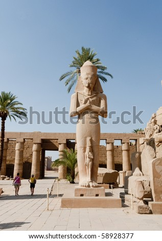 Enormous statue of Ramses II (1279-1213BC)in the Amun Temple complex, Karnak, Luxor, Egypt. - stock photo