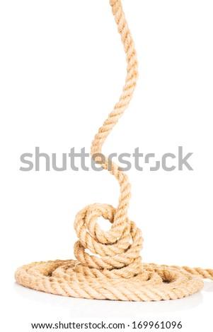 Enrolled rope. Isolated on white. - stock photo