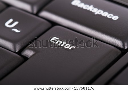 Enter key on black computer keyboard. - stock photo