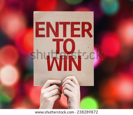 Enter to Win card with colorful background with defocused lights - stock photo