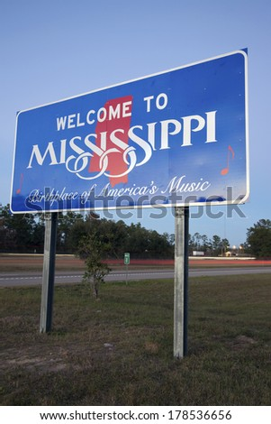 Entering Mississippi - welcome sign and traffic on I-10