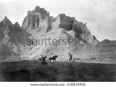 Entering the Badlands, Three Sioux Indians on horseback, photograph by Edward S. Curtis, 1905 - stock photo