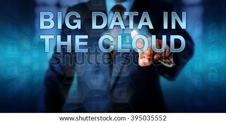 Enterprise manager is pressing BIG DATA IN THE CLOUD on a virtual touch screen interface. Information technology concept and computer security metaphor for data infrastructure moving into the cloud.