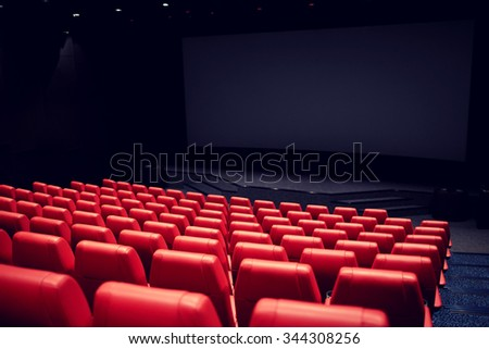 entertainment and leisure concept - movie theater or cinema empty auditorium with red seats - stock photo