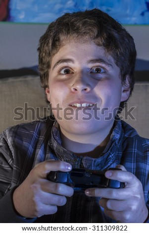 Entertainment. boy with joystick playing computer game at home. - stock photo