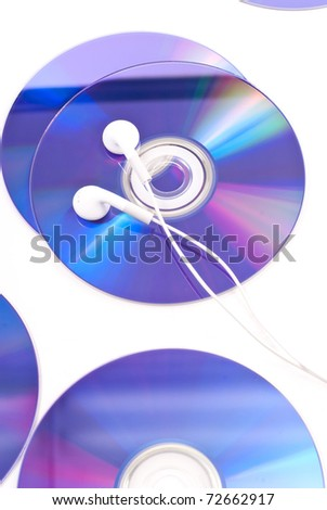 Entertainment industry concept image with cd's and music headphones - stock photo