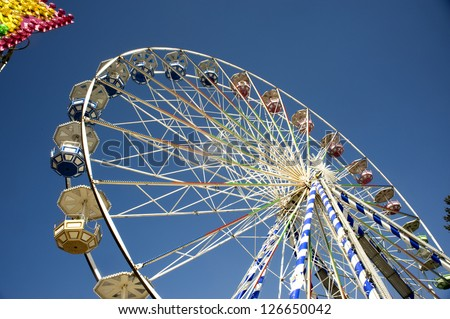 Entertainment on an attraction a survey wheel - stock photo
