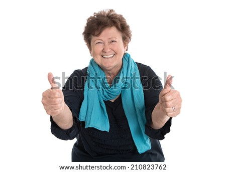 Enthusiastic and happy grandmother making thumbs up gesture with two fingers. - stock photo