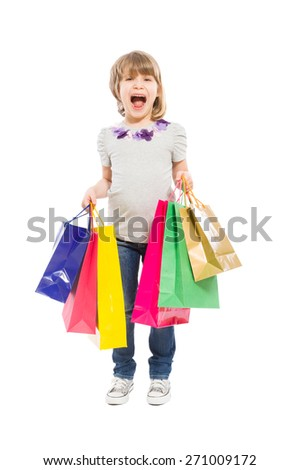 Enthusiastic and young shopping girl holding paper bags on white background - stock photo